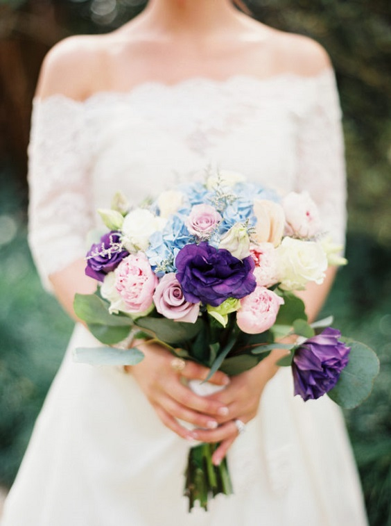 white bridal gown and bouquet for dusty blue and purple fall wedding 2020