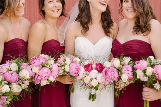 burgundy bridesmaid dresses and pink bouquets for burgundy and pink wedding in country barn