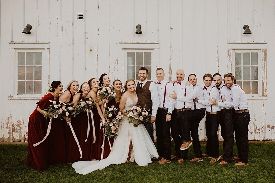 white bridal gown and maroon bridesmaid dresses for white barn wedding colors white and maroon