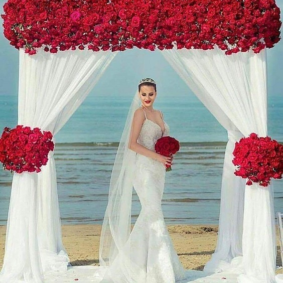 red and white wedding ceremony arch for beach red and white wedding